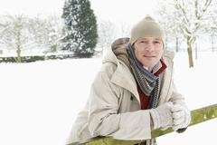 Man Standing Outside In Snowy Landscape - stock photo