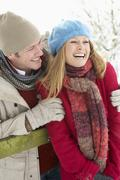 Couple Standing Outside In Snowy Landscape - stock photo