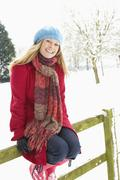 Woman Standing Outside In Snowy Landscape Stock Photos