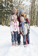 Family Walking Through Snowy Woodland Stock Photos