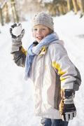 Boy About To Throw Snowball In Snowy Woodland - stock photo