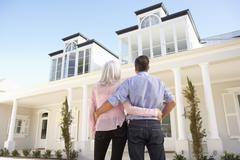 Senior Couple Standing Outside Dream Home Stock Photos