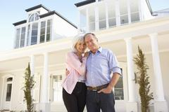 Senior Couple Standing Outside Dream Home - stock photo
