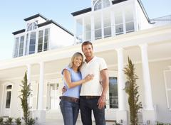 Young Couple Standing Outside Dream Home Stock Photos