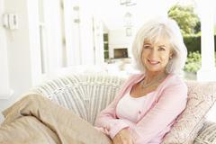 Portrait Of Senior Woman Relaxing In Chair - stock photo