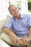 Portrait Of Senior Man Relaxing In Chair - stock photo