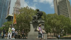 Tourists & workers walk past Queen Victoria in Sydney Stock Footage