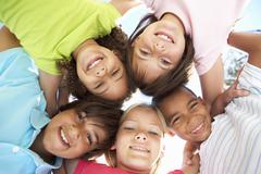 Group Of Children Looking Down Into Camera - stock photo