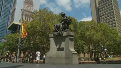 Timelapse Tourists & workers walk past Queen Victoria in Sydney Stock Footage