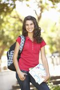 Female Teenage Student In Park - stock photo
