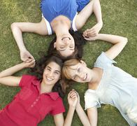Group Of Teenager Girls Looking Up Into Camera Stock Photos