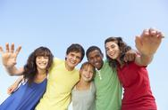 Stock Photo of Group Of Teenage Friends Standing Outside