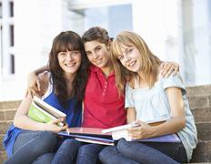 Group Of Teenage Female Friends Sitting On College Steps Outside Stock Photos