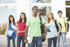 Group Of Teenage Students Standing Outside College Building Stock Photos