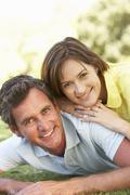 Stock Photo of Portrait Of Romantic Couple In Park