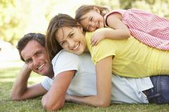 Young Family Relaxing In Park - stock photo