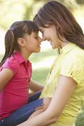 Portrait Of Mother And Daughter Together In Park - stock photo