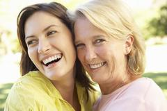 Portrait Of Senior Woman With Adult Daughter - stock photo