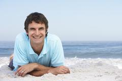 Young Man Relaxing On Sandy Beach Stock Photos