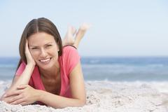 Young Woman Relaxing On Sandy Beach Stock Photos