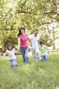 Family Enjoying Walk In Park Stock Photos