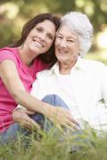 Senior Woman With Adult Daughter In Park - stock photo