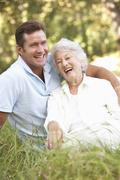 Senior Woman With Adult Son In Garden Stock Photos