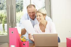 Couple Using Laptop At Home Stock Photos