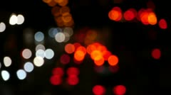 Blurry street lights at night, defocused lights of nightly traffic Stock Footage