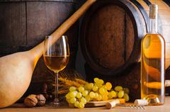 traditional white wine and barrels - stock photo