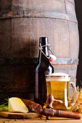 wooden barrel with beer and food - stock photo