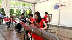 ASIAN MUSICIANS PERFORM AT ASIAN FESTIVAL Stock Footage