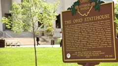 COLUMBUS OHIO STATEHOUSE - SIGN - PEOPLE WALKING IN BACKGROUND Stock Footage
