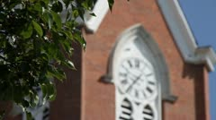 OLD CHURCH STEEPLE - TREE IN FOREGROUND - GERMAN VILLAGE Stock Footage
