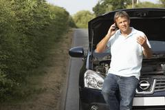 Driver Broken Down On Country Road - stock photo