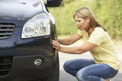 Stock Photo of Female Driver Broken Down On Country Road