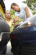 Man And Woman Having Argument After Traffic Accident Stock Photos