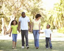Portrait of Happy Family Walking In Park Stock Photos