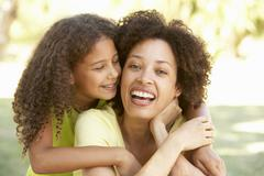 Portrait Of Mother And Daughter In Park Stock Photos