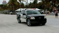 Policecar on south beach Stock Footage