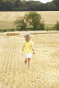 Girl Running Through Summer Harvested Field Stock Photos
