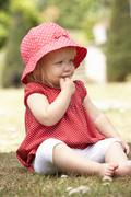 Young Girl Playing In Garden At Home - stock photo