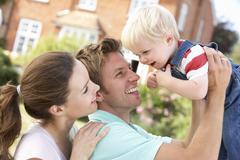 Family Playing Together In Garden At Home - stock photo