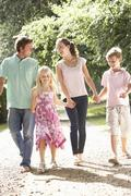 Family Walking In Countryside Together Stock Photos