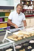 Man Working Behind Counter In Café Stock Photos