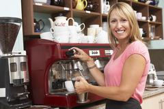 Woman Making Coffee In Café - stock photo
