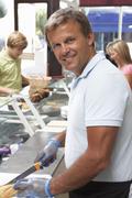 Man Working Behind Counter In Café Stock Photos