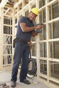 Construction Worker Building Timber Frame In New Home Stock Photos