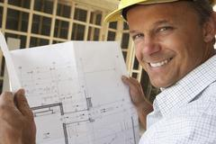 Architect With Plans In New Home Stock Photos