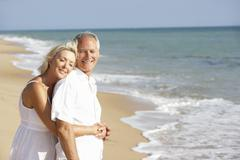 Senior Couple Enjoying Beach Holiday - stock photo